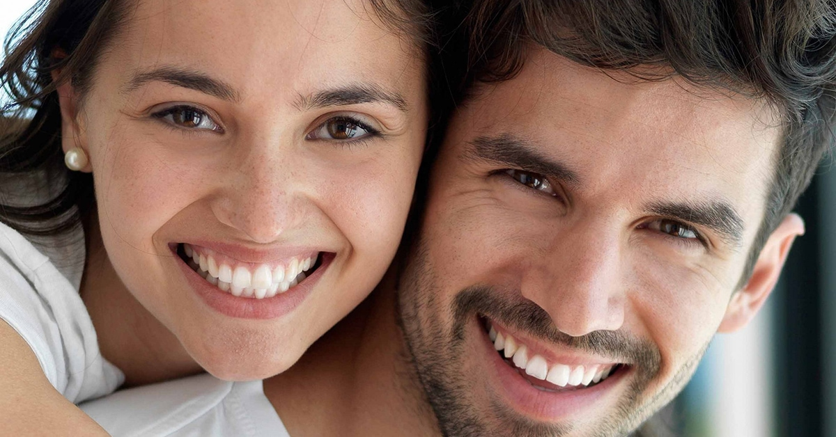 couple smiling with nice teeth in east sussex
